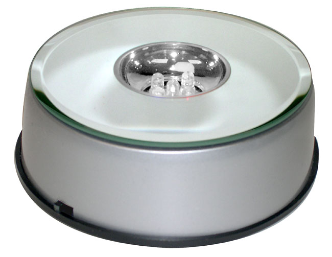 Display Bases With Mirror Tops And Lights Revolving